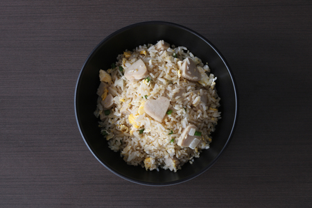 Fried rice with white pork sausage and egg top view