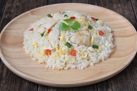 Fried rice with chicken on wood blackground,close up
