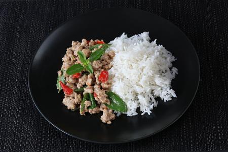 Thai spicy food,stir fried pork with basil (Pad Ka Prao Moo)and steamed rice.This popular Thai dish.