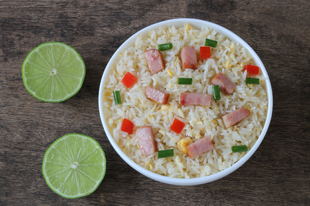 Fried rice with bacon and egg on wooden background Archivio Fotografico