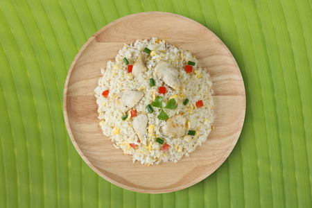 Fried rice with chicken on banana leaf.Thai style call Archivio Fotografico