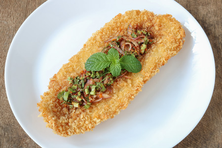 Fried fish fillet with spicy sauce  on wooden blackground,close up Stock fotó