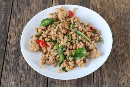 Stir fried minced pork with basil close up.This popular Thai dish serve with steamed rice.Homemade meal
