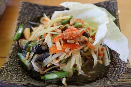 Thai papaya salad ( Som Tum Thai ).Thai style will serve with steamed sticky rice