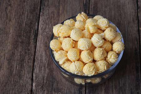 Sweet popcorn on wooden back ground.Caramel popcorn