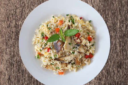 Fried rice with mackerel and egg top view on wood background Archivio Fotografico
