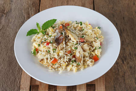 Fried rice with mackerel and egg on wood background Archivio Fotografico