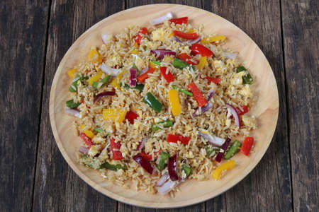 Fried rice with sweet pepper and egg.Homemade meal for good health Archivio Fotografico