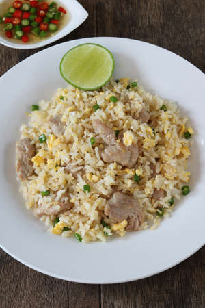 Fried rice with pork and egg close up.Thai style call