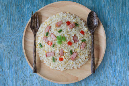 Fried rice with bacon on wood background top view
