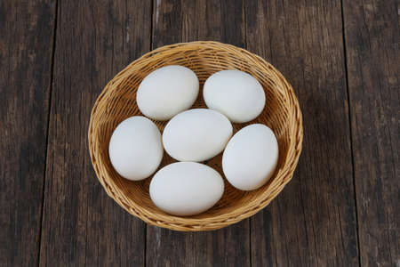 Salted duck eggs  in basket  on old wooden background. Archivio Fotografico