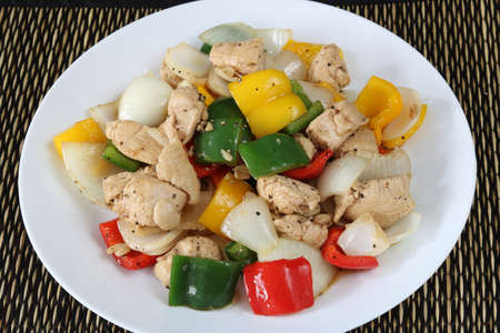 Stir fried chicken and sweet pepper close up.Homemade meal for good health