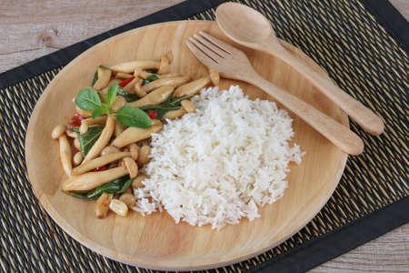 Thai food,stir fried shimeji mushroom with basil and steamed rice close up.This popular Thai dish.