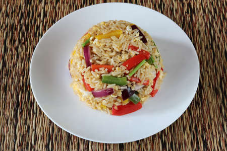 Fried rice with sweet pepper and egg close up .Homemade meal for good health