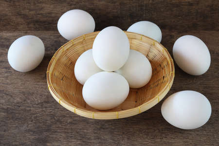 Salted duck eggs  in basket on old wooden background Archivio Fotografico