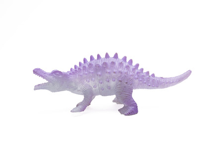 Dinosaur toy plastic figures on white background