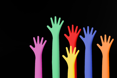 The Colour hands up image closeup