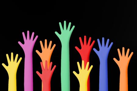 The Colour hands up image closeup