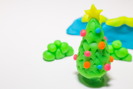 The christmas tree play dough  close up image on white background.