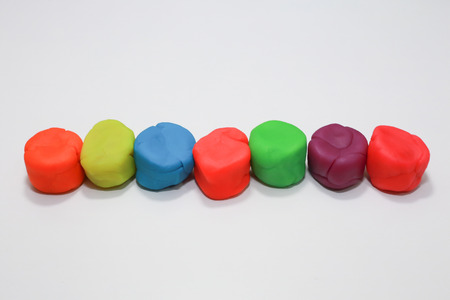 The colorful playdough close up image on white background.