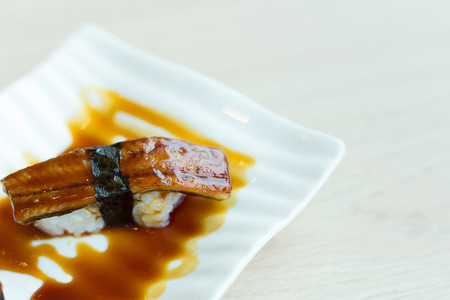 image close up unagi sushi on white mood in japanese  restaurant