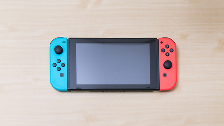 Thailand , Bangkok - MAY 7, 2018 A Nintendo Switch game console on table. Redactioneel