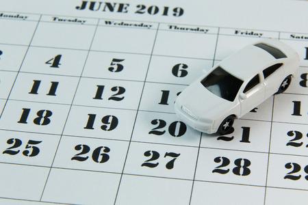 The white car on calendar background image close up. Archivio Fotografico