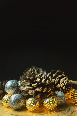 The christmas ball and Pine cones  on wood  background. Stock Photo