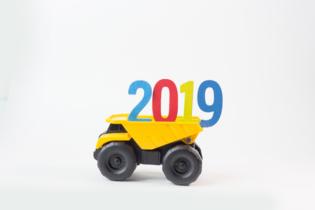 Yellow truck hold 2019 number on white background. Stock Photo