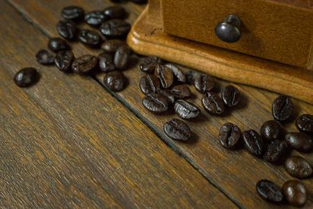 The vintage roaster coffee  on wood table. Foto de archivo