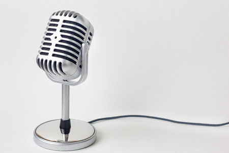 vintage microphone close up image on white background.