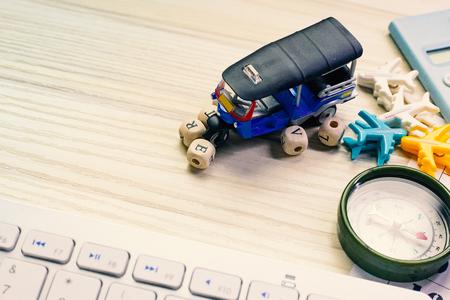 The tuktuk on white  office  table for travel content. Imagens