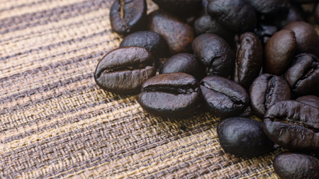 The coffee roasted on wood texture close up image.