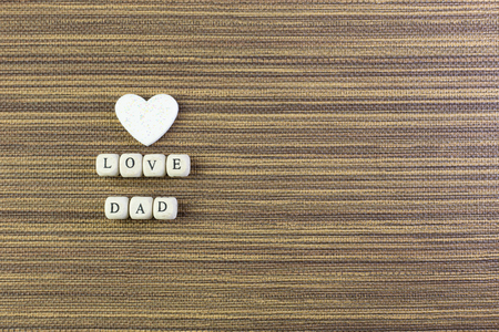 The wooden text  for father day content close up image.