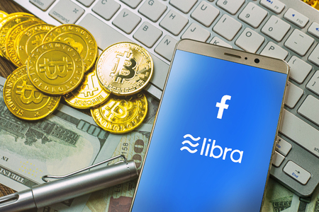 Bangkok, Thailand - Sat 22 June 2019: The Libra Facebook and bitcoin cryptocurrency for Libra Facebook content. Sajtókép