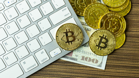 The Bitcoin coin on silver keyboard for  cryptocurrency content.