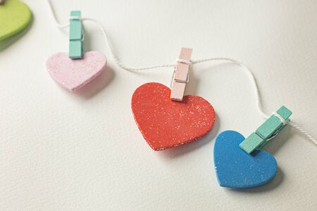 The multicolour  heart on white  background  for valentines day content.