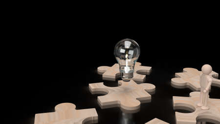 Light bulb and wood human figure on jigsaw 3d rendering. 写真素材