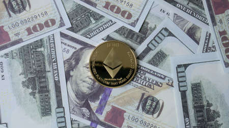 ethereum coin and banknote 100 dollar  top view image for business content Reklamní fotografie