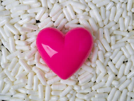heart  and white capsules image  for  sci or medical content.