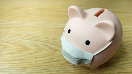piggy bank and mask for money and virus crisis content 写真素材 - 167303722