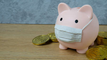 piggy bank and mask for money and virus crisis content