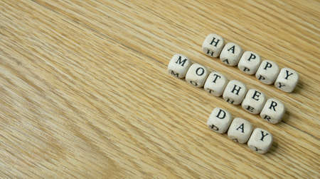 wood cube word happy mother day for holiday concept 免版税图像