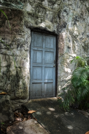 old wood door in stone wall photo