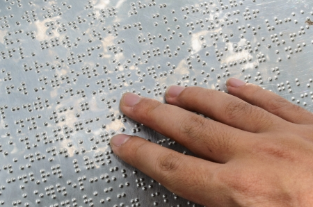 close up reading braille photo