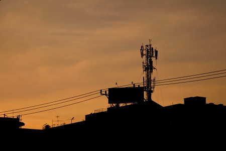 woderful: Silhouette of communication antenna in a woderful sunset