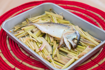 Mackerel fish on a grill with lemongrass  Stock Photo