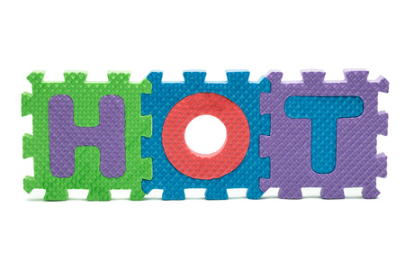 word HOT formed with colorful foam puzzle toy isolated on white blackground Stock Photo