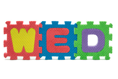 word WED formed with colorful foam puzzle toy isolated on white blackground