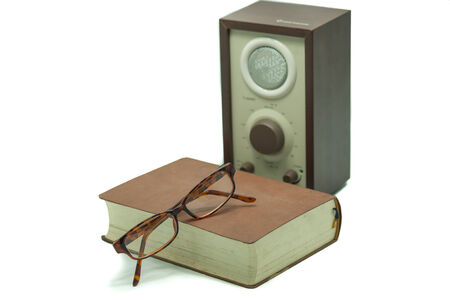 Old Vintage Speaker, glasses and book isolated on white background photo